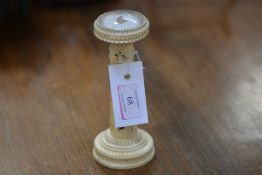 A late 19th century carved ivory desk thermometer and compass, the compass within a beadwork and