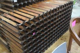 A large vintage double-sided wine rack. 162cm by 88cm by 54cm