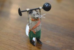 "A Schuco clockwork velvet mouse, lifting dumbells, marked ""Schuco Patent Foreign""."