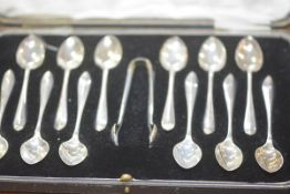 A cased set of twelve George V silver teaspoons and sugar tongs, Sheffield 1926 and 1927, each spoon