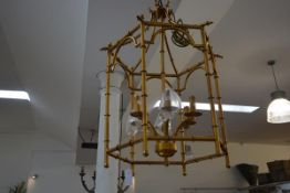 A large gilt-metal bamboo cast six-light hanging hall lantern. 84cm by 59cm