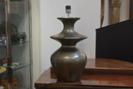 A contemporary table lamp of shaped baluster form with metallic glaze. 52cm excluding fitting.
