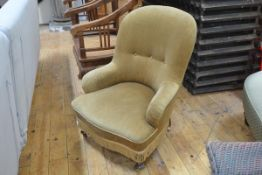 A Victorian spoon back nursing chair, upholstered in olive green velvet, on turned legs and