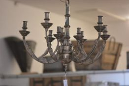 A contemporary eight light white metal chandelier in the Gothic taste. Length approx. 58cm excluding