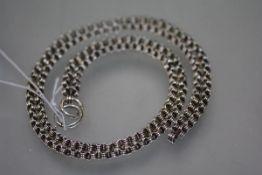 An Edwardian silver chain, of fancy links, unmarked. 23 grams