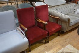 A pair of early 20th century mahogany framed open armchairs, in red velvet.