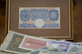 A group of GB and other banknotes including: a Bank of England Peppiatt blue one pound note; British