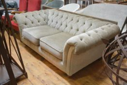 A Chesterfield sofa in 19th century style, upholstered in velvet, with two loose-cushioned seat,