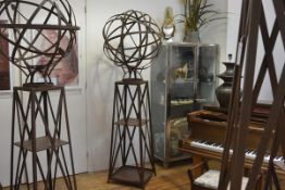 A large weathered cast steel garden armillary sphere on stand, the open trellis sphere on a tapering