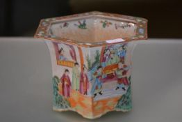 A Canton porcelain hexagonal jardiniere, probably 19th century, painted in the famille rose
