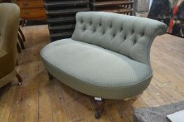 A Victorian button back window love seat, with shaped arched back over a bowed seat, raised on