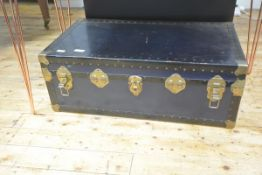 A brass-bound trunk, c. 1900, initialled to each end. 33cm by 92cm by 52cm