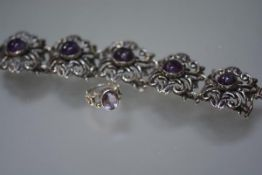 A substantial Mexican sterling silver bracelet mounted with five amethyst cabochons; together with a