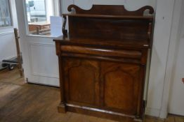 An early Victorian mahogany chiffonier, with scroll-carved superstructure, the base with a frieze