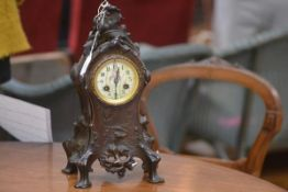 A French patinated bronze mantel clock, c. 1900, the case cast and chased in the Art Nouveau taste