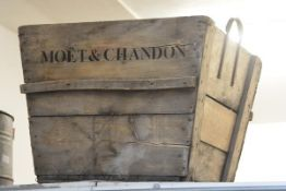 A very large wooden planter, inscribed Moet & Chandon. 54cm by 70cm by 60cm
