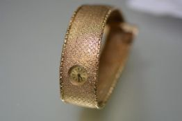 Cortebert, a vintage lady's 9ct gold wristwatch, the gilt dial with baton numerals within a broad