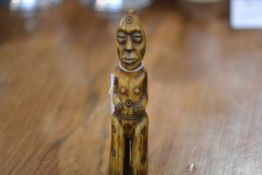 A carved slit figure of Oceanic type, late 19th/early 20th century 15cm