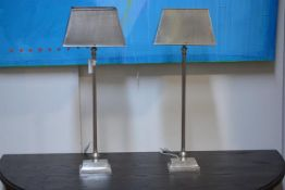 A pair of contemporary white metal table lamps, each with tapering rectangular shade. Height 80cm