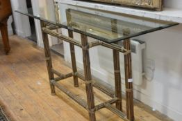 A bamboo and glass console table, the rectangular bevelled top raised on clustered bamboo legs. 90cm