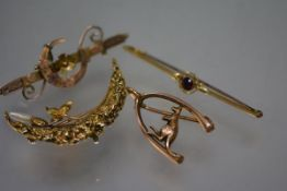 An early 20th century 9ct gold brooch modelled as a kangaroo within a wishbone; a late Victorian 9ct