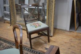 A George III mahogany side chair, with X-form back over a needlework seat.
