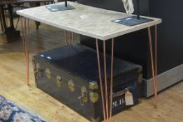 A contemporary side table, the rectangular chipboard top raised on tubular copper legs. 74cm by