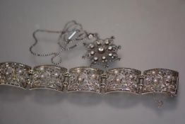 A striking sterling silver and pearl bead bracelet in the Art Deco taste, formed of five plaques,