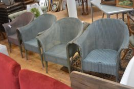 A group of Lloyd Loom furniture: four tub armchairs, three in blue and one in pink/blue. (4)