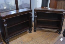 A pair of rosewood low bookcases in the Regency taste, each inverted breakfront top above adjustable