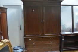 A George III mahogany linen press, the top with moulded cornice above a pair of doors with arched