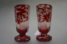 A pair of Bohemian ruby cut to clear glass vases, c. 1900, each of tapering octagonal form, the