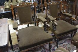A pair of Edwardian inlaid rosewood open armchairs, en suite with the preceding lot. (2)