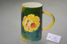 "A large Wemyss Pottery ""Jazzy"" ware tankard, of tapering cylindrical form, decorated with yellow"