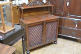 A small William IV rosewood chiffonier, the shelved superstructure with scroll and anthemion