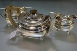 A three piece silver tea service in the Regency taste, Chester 1932, each piece of bellied form,
