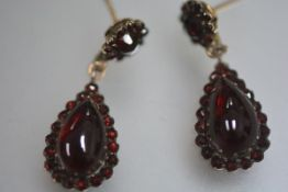 A pair of late 19th century gilt-metal mounted garnet drop earrings, possibly Austrian, post
