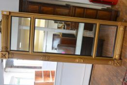A George IV gilt-composition tripartite overmantel mirror, each plate within a reeded ebonised