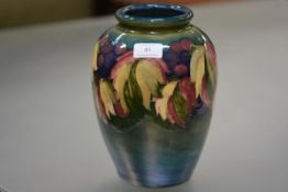 A large William Moorcroft leaf and berry pattern vase, of baluster form, tubelined and painted