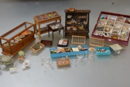 A group of 20th century doll's house accessories relating to food and drink including; a large