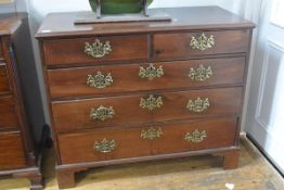 A George III mahogany chest of drawers, the rectangular moulded top above two short and three long
