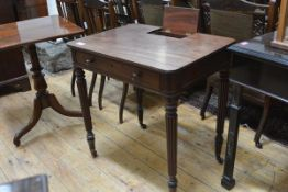 A William IV mahogany writing table, the rectangular top with rounded corners and inset pen and