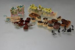 A quantity of 20th century doll's house accessories including: a group of log baskets; carpet