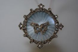 An Edwardian diamond set enamel brooch pendant, of circular form, the sky blue engine-turned