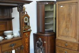 A George III inlaid mahogany bowfronted standing corner cupboard, the upper section with moulded
