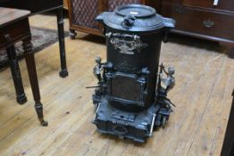 A French parcel-gilt cast-iron portable stove, c. 1870, Choubersky, Paris, of cylindrical form,