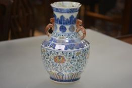 A Chinese porcelain baluster vase, of shouldered form, with iron red scroll handles, bands of