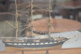 A scratch built painted wooden and bone model of a three-masted man o' war, of prisoner-of-war type,