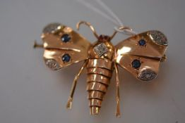 A late 19th century sapphire, diamond and ruby set insect brooch, designed as a moth with ruby eyes,