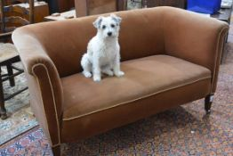 A small Edwardian mahogany-framed sofa of Chesterfield type, velvet upholstered, on square section
